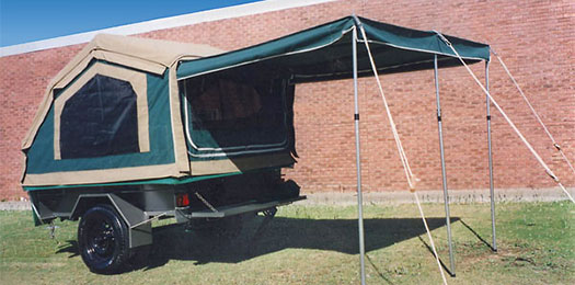 Compact canvas camper trailer with awning up