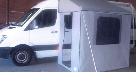 Campervan fitted with custom designed canvas half annexe